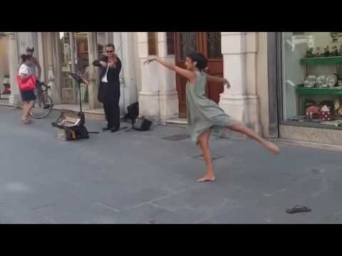 Ballerina from Palestine could not resist the melody of a street musician in Italy - YouTube