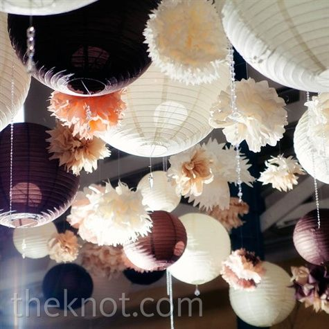 The combination of chinese lanterns of various sizes/shapes (lit and lot lit) in combination with poms. Keep to white/ivory with maybe a pop of blue