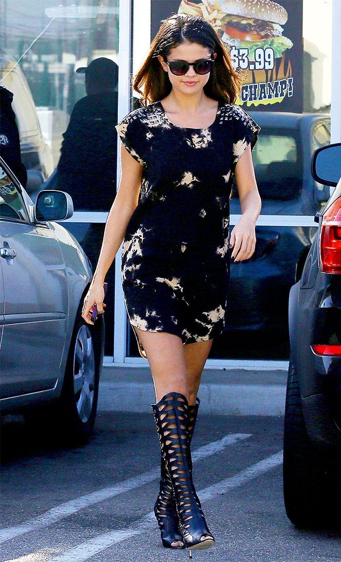 Selena Gomez in a black floral printed dress + black knee high sandals