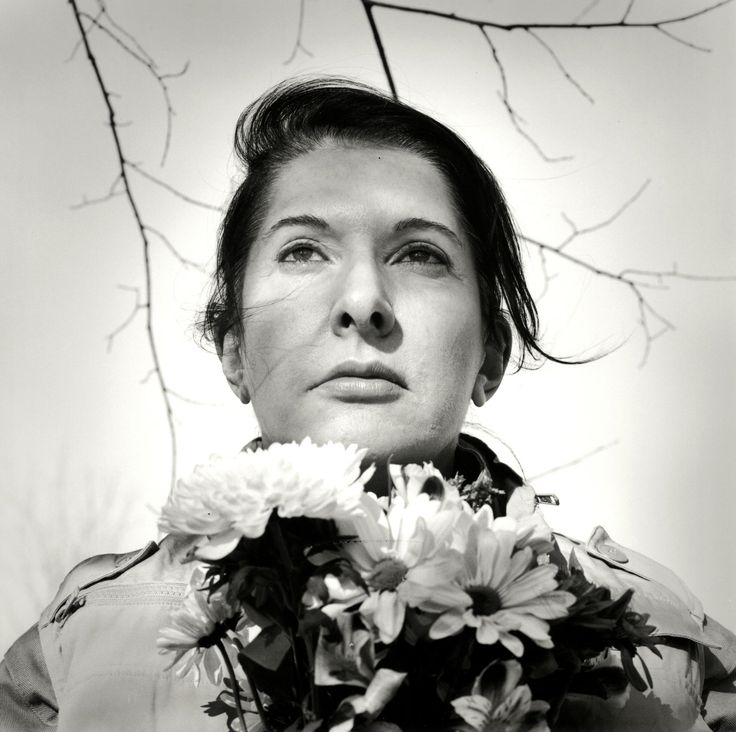 Marina Abramović // Portrait with Flowers // 2009 // Avant-garde/Performance // part of the earliest experiments in performance art, and she is one of the few pioneers of that generation still creating new work, challenge the limits of the body