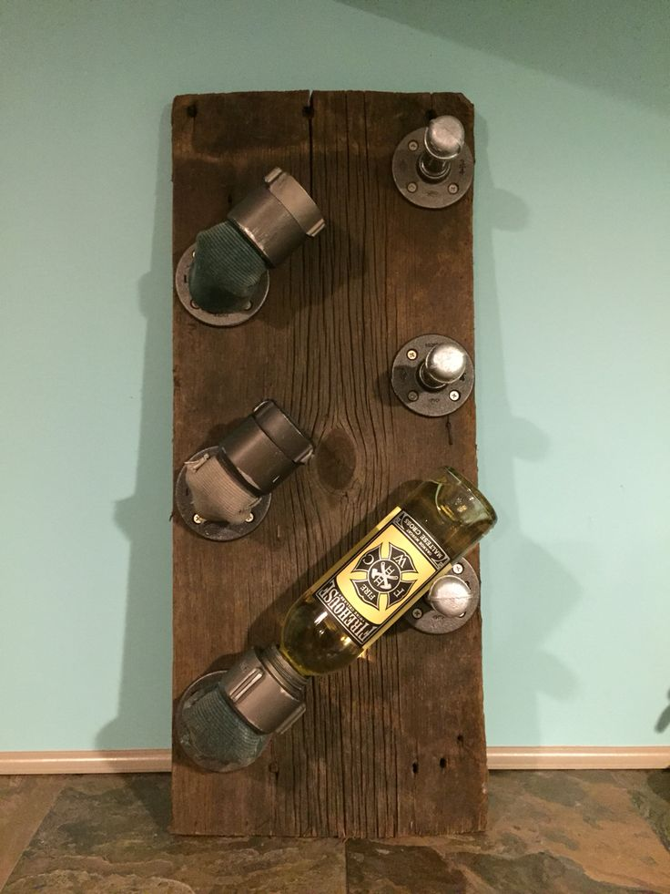 Wine rack from recycled fire hose couplings and barn wood