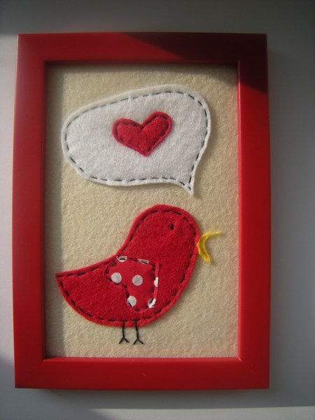 Felt picture in frame. Bird tweet about love
