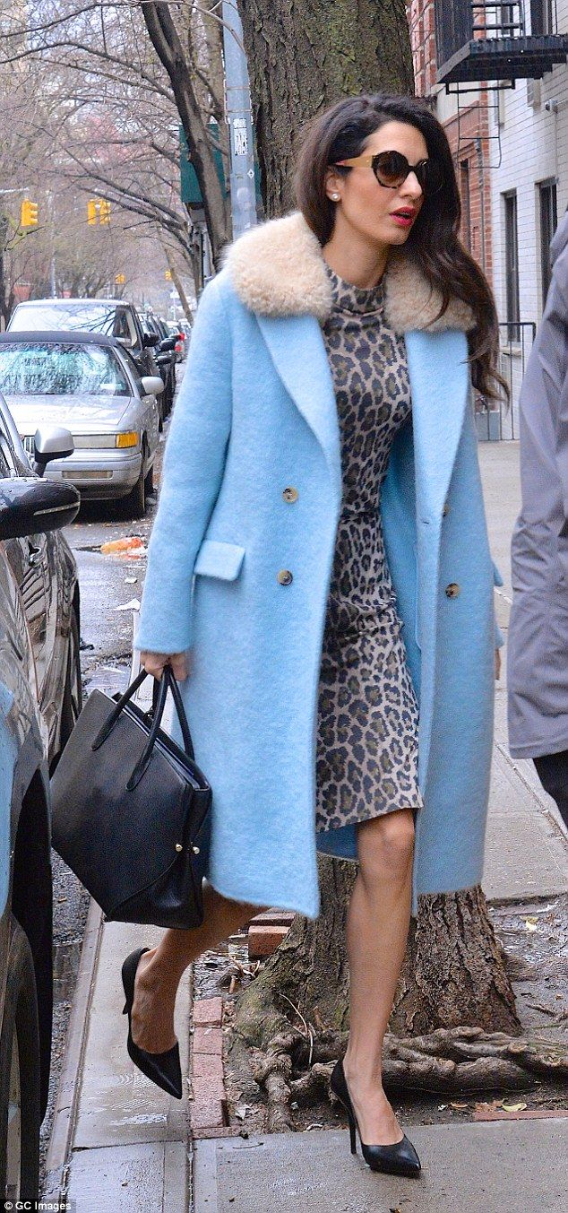 Power outfit: Amal Clooney upped the fashion stakes once again as she stepped out in New York in another high-fashion outfit on Friday