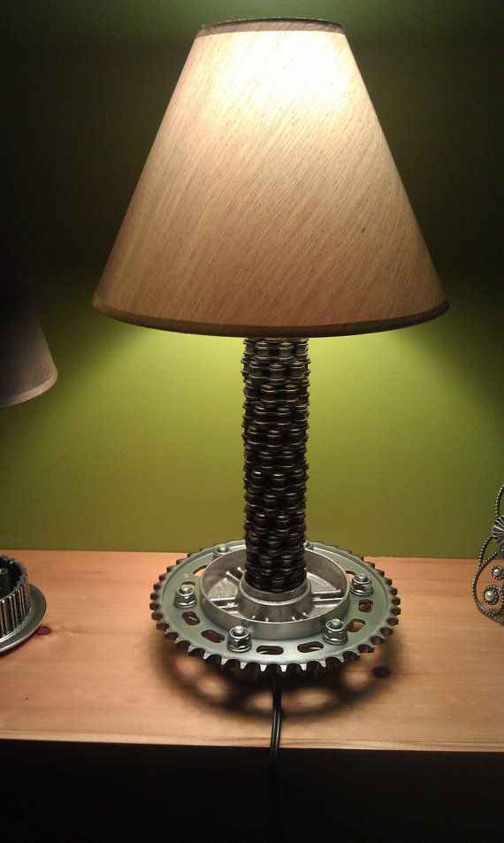Hey, I found this really awesome Etsy listing at http://www.etsy.com/listing/119626747/motorcycle-chain-and-sprocket-lamp