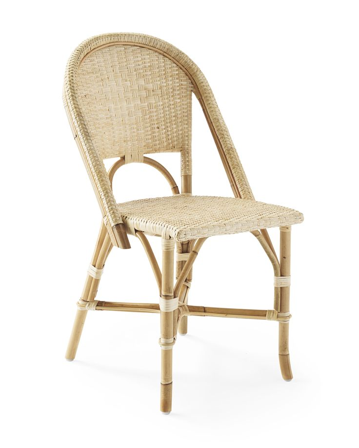 A classic 1930s European bistro chair, reinterpreted in a versatile all-natural shade. Crafted with a rattan frame and woven rattan seats, it's great for the kitchen or the patio. (Just remember to store it indoors when the rains come.) Look closely and you'll notice the wonderfully organic marks created while bending and stretching the rattan by hand – a time-honored technique perfected by the French.