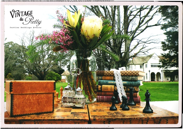 This is a Vintage & Pretty chessboard themed table setting.    Venue: Longwood, Featherston  Flowers: Daisy a Day, Te Aro, Wellington