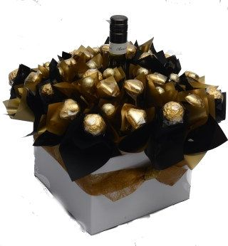 A bottle of Reisling with Ferrero Rochers and solid chocolate hearts and baubles