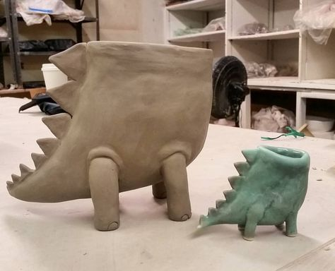Working on a headless dino succulent planter #dinosaur #clay #ceramic #handbuilt #succulents #plants #planter
