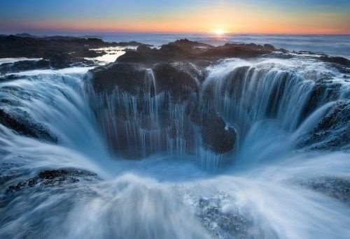 Thor's  Well – Cape Perpetua, Oregon. At moderate tide and strong surf, flowing water creates a fantastic landscape