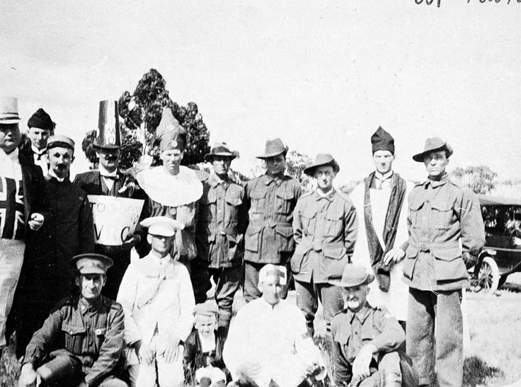 A group of soldiers celebrating the Armistice. Some are in military uniform and some in fancy dress (staging a mock funeral), Kaniva, 1918.