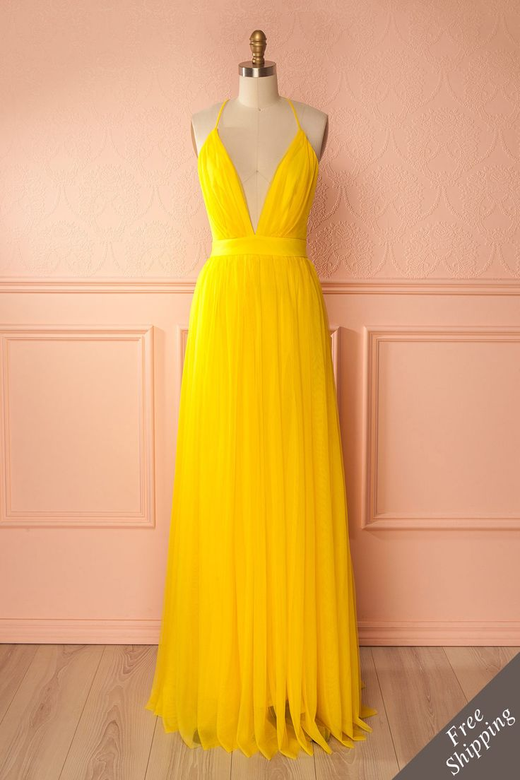 Elif Soleil #boutique1861 / You'll make a memorable impression in this beautifully refined dress! The long ethereal tulle skirt will gently rock with each step you take, while the plunging neckline and the open back is sure to turn heads. Thanks to its adjustable straps and stretchy lining, you can dance the night away with ease!  Yellow maxi dress with tulle. Perfect Gala, Bridesmaids, wedding