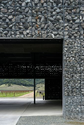 Omg, I live this.  Is like hesko baskets filled with big rocks.  Think how it would look with colors rocks! Or fabricated country pieces.  Herzog & de Meuron. Dominus Winery #3