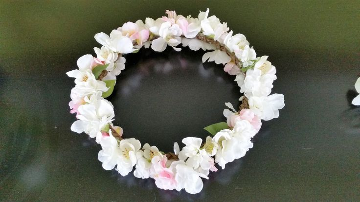 A crown of spring flowers, apple blossom an, roses and stocks.  I just love making these for brides with their choice of flowers