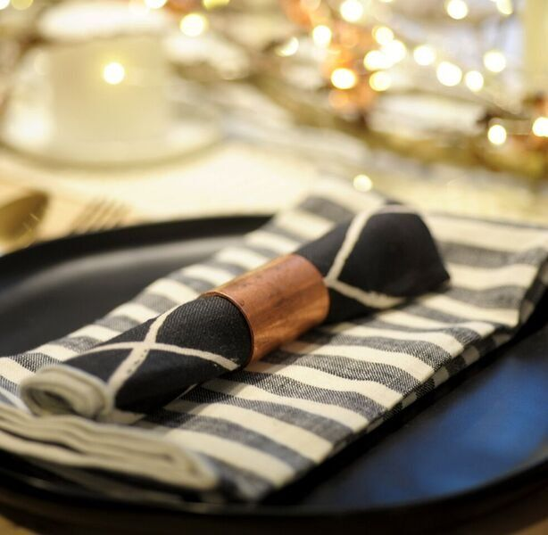 Cut down copper pipes for simple industrial napkin rings. This chic tablescape looks expensive but won't break the bank.