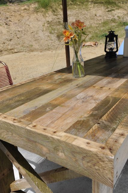 This rustic dining table isn't a vintage find, it's actually a beautiful piece made from three discarded shipping pallets! Using just a handful of nails and screws, some v33 Aquastop, and thrown-o