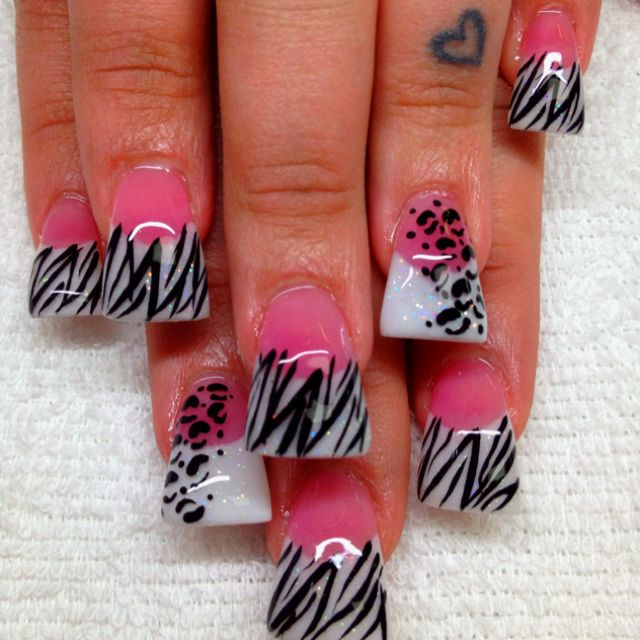 Flared pink and white acrylic nails with zebra and leopard print designs