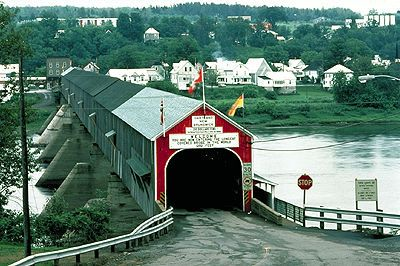 The Hartland Bridge in Hartland, New Brunswick, is the world's longest covered bridge, at 391 metres (1,283 ft) long. It crosses the Saint John River from Hartland to Somerville, New Brunswick, Canada. The framework consists of seven small Howe Truss bridges joined together on six piers.