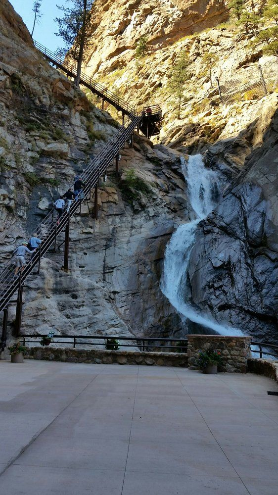 Seven Falls (Colorado Springs) | What better way to begin your trip than by seeing seven cascading waterfalls at once? For an even more delightful experience, visit during the evening hours to see the Falls light up in an array of vibrant colors.