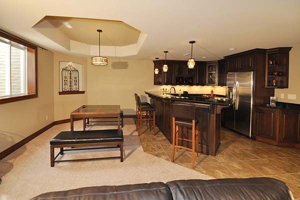 Ashland - Victory Homes of Wisconsin, Inc. Lounge area and wet bar in lower level