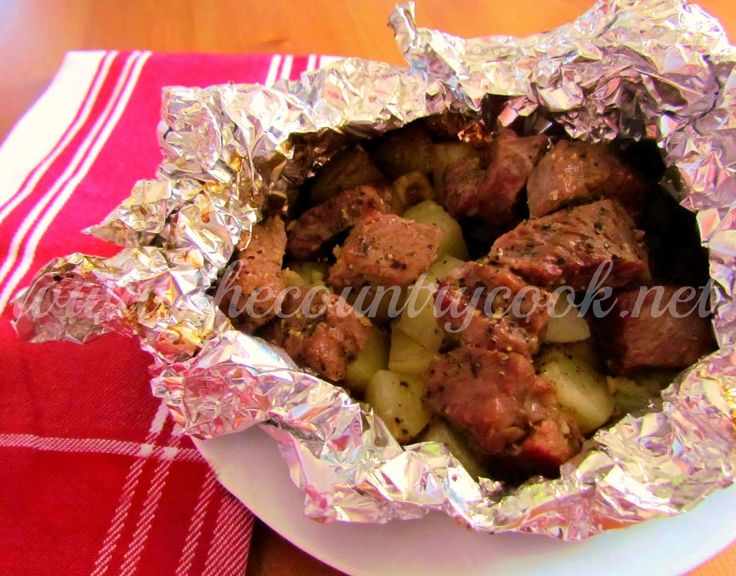 The Country Cook: Hobo Packets 2-3 steaks, potatoes, olive oil, garlic, onion, salt  & pepper; steak seasoning optional.  Cube everything Place in 4 squares of foil w/butter on top; grill 35-40 min.@ 350