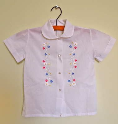 White Cotton Embroidered Girls Shirt 12.00 Beautiful girl's summer blouse from our range of vintage clothes for kids.  Lovely white embroidered cotton shirt. Great condition.  Size 2-4 years  Customise with some of our kids accessories