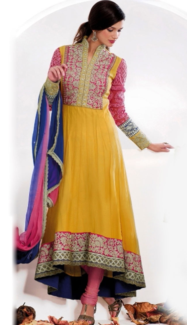 Ultimate collection of embroidered suits with fabulous style.   The dazzling yellow faux georgette churidar suit have amazing embroidery patch bordered work is done with resham, zari, sequins and beads work.   Beautiful embroidery work on kameez is stunning.   The entire ensemble makes an excellent wear.   Contrasting pink santoon churidar and shaded chiffon dupatta is available with this suit.   Slight Color variations are possible due to differing screen and photograph resolutions.