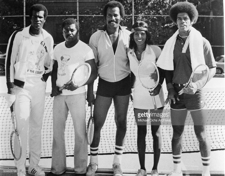 Tony King, D'Urville Martin, Fred Williamson, Pam Grier and Jim Kelly pose for a portrait playing tennis on the streets of Harlem 1975 in in New York.