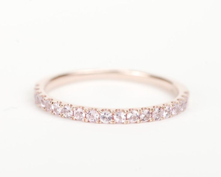 Pave eternity band with morganite stones.