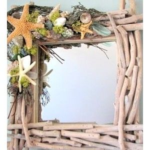 shell and driftwood art - would make a great wreath too.