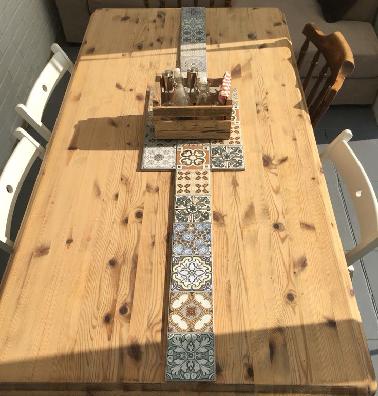 Leftover tiles used to protect the table - waste not, want not!