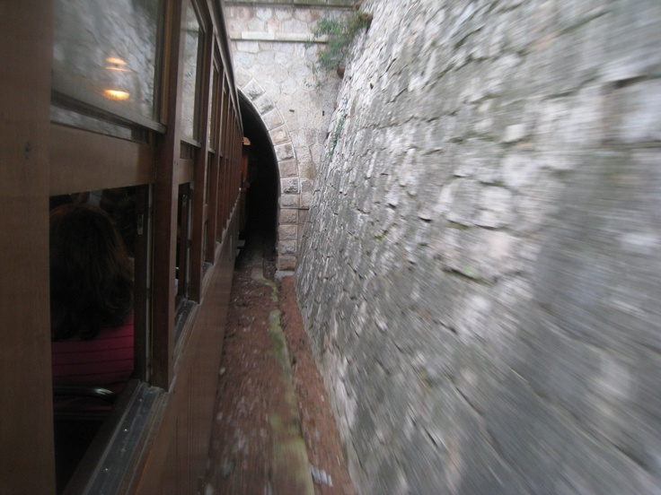 We are about to enter the Tunnel to a Valley in the Forest. This part of untouched nature can only be see on this Train Trip. ----- More Information: http://www.nofrills-excursions.com/excursions-tours-thingstodo/port-alcudia/a-day-in-lluc-and-soller/