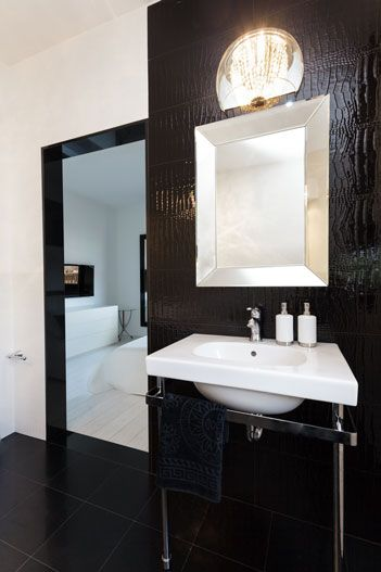 Two Mirrors In The Bathroom A Large Black Framed Floor Mirror And A Silver