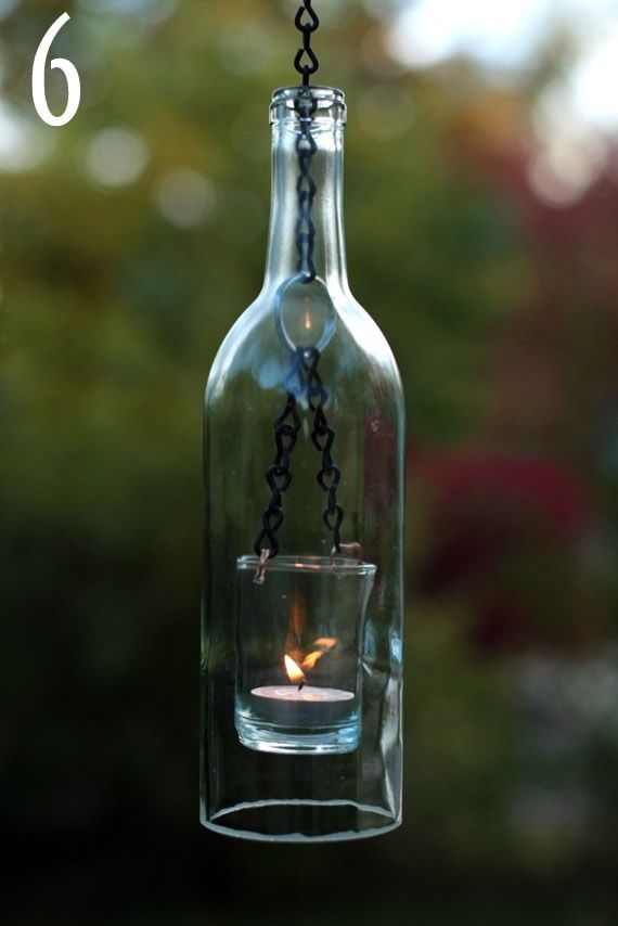 Wine bottle candle holders also cool on the patio (outdoor family room)