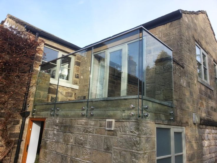 Frameless balcony balustrade design with toughened and laminated glass panels and stainless - Wooden balcony design ideas perfect harmony ...