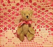 "2 1/4"" teddy bear, when standing.  Jointed."