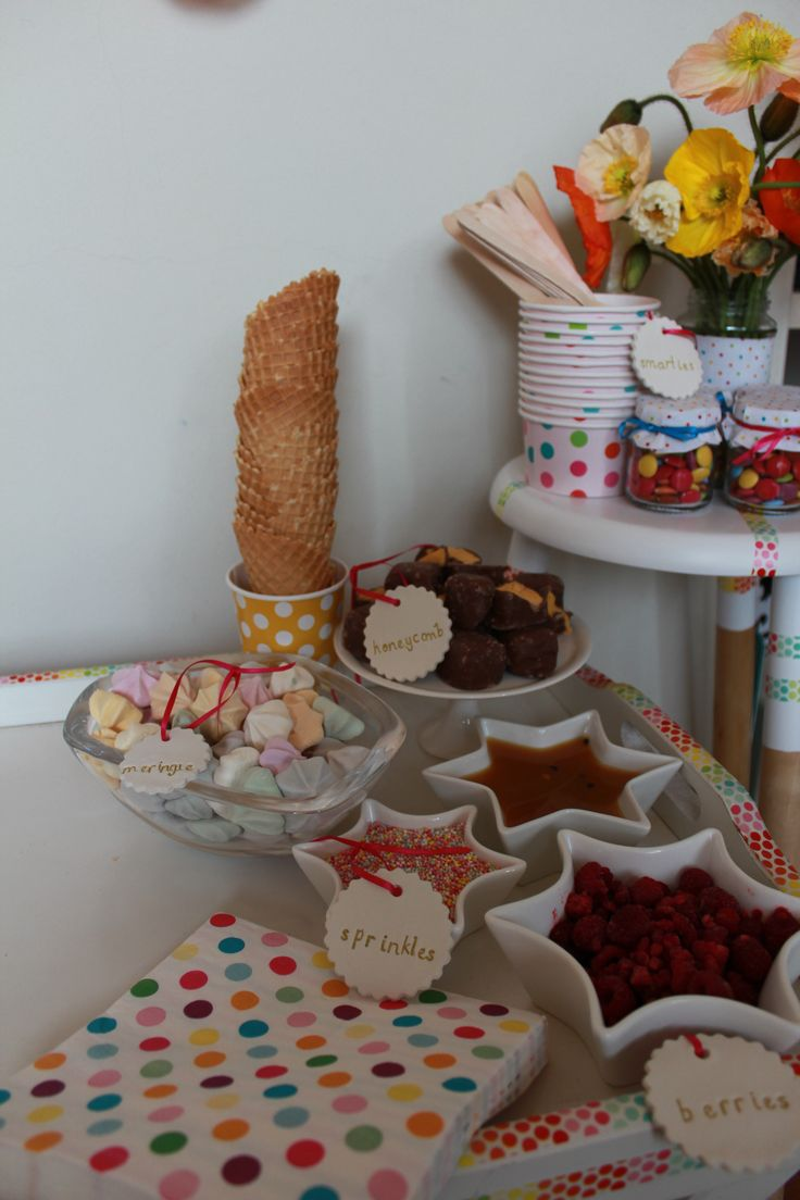 Ice cream buffet toppings - berries, sprinkles, meringues, choc honeycomb and waffle cones