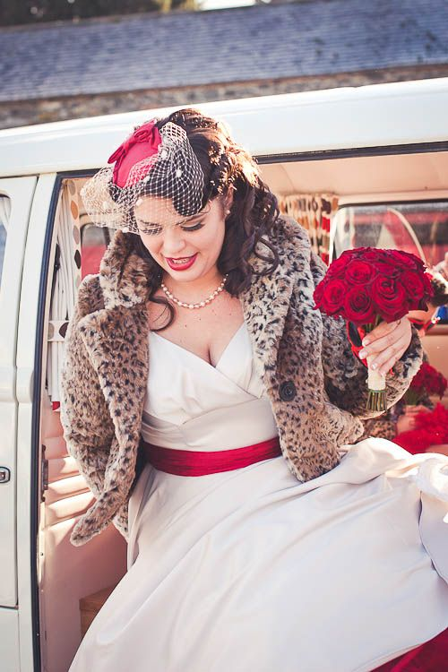 White with red wedding dress, birdcage veil, and Leopard coat....yes, yes, yes!