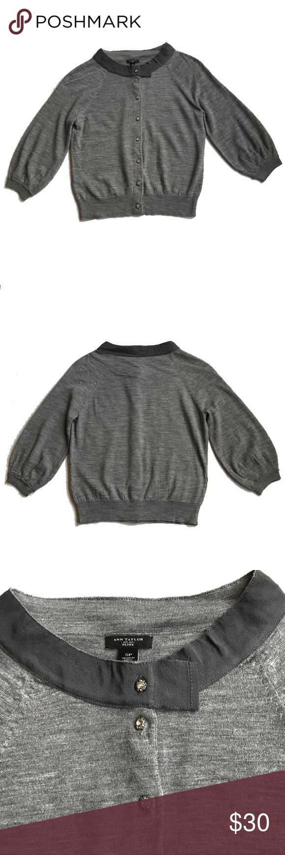 """💕Ann Taylor Gray Merino Wool Petite Cardigan Beautiful cardigan with amazing details! Gently used, like new condition! Buttons are silver with beautiful clear stones ( all in tact), 3/4 length gathered sleeves.  Ribbon trim on neck. Approx Measurements: 20"""" long from shoulder to hem, 16"""" armpit to armpit. Merino wool, dry clean. Ann Taylor Sweaters Cardigans"""