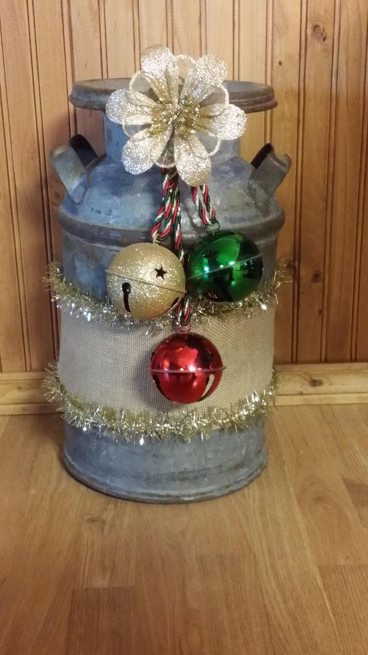 Old milk can decorated for Christmas.