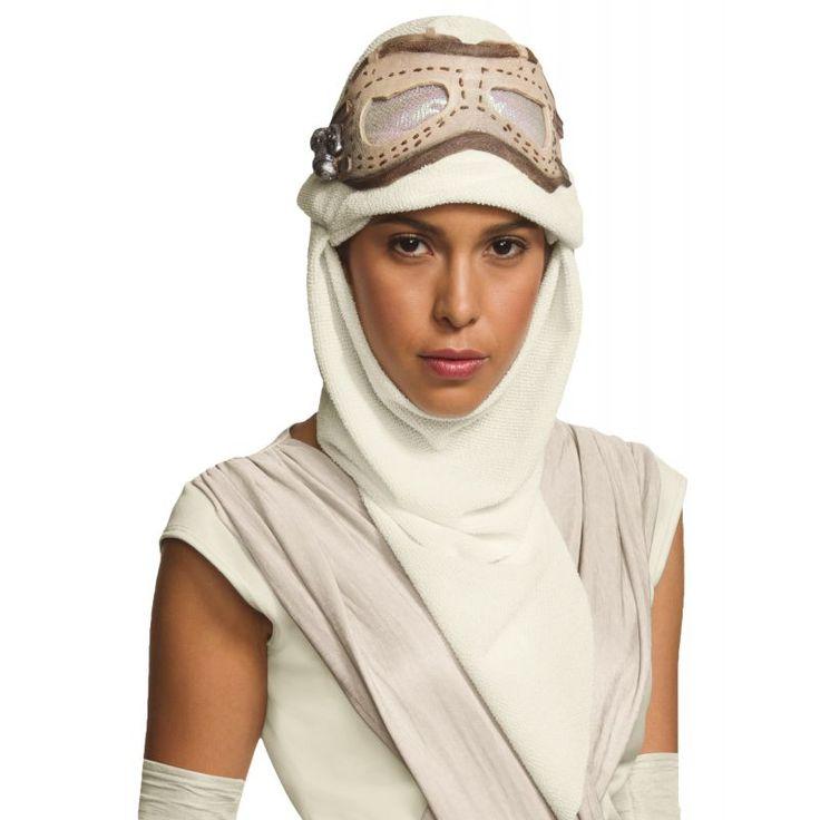 Ce masque de Rey™ pour adulte est sous licence officielle Star Wars™.  Il se compose d'une cagoule en tissu blanche, qui laisse le visage découvert. Cette cagoule est complétée par un loup en latex. Un voile aux reflets verts est présent au niveau des yeu