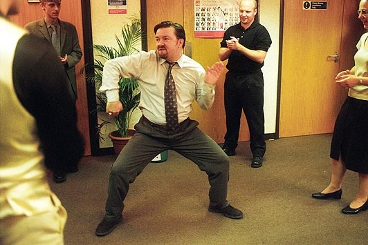 Ricky Gervais as David Brent in The Office -- probably the funniest,  yet the worst, office manager ever -- can't get enough of him or look away!!