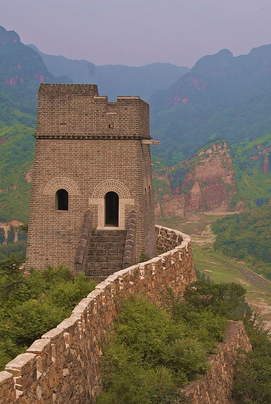 A guard tower on the Great Wall sits atop a high cliff at Huangyaguan in Hubei Province.