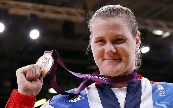 Warrior: Team GB's Karina Bryant poses with her bronze medal after battling through the women's +78kg judo event to place third after eventually loosing in the semifinal