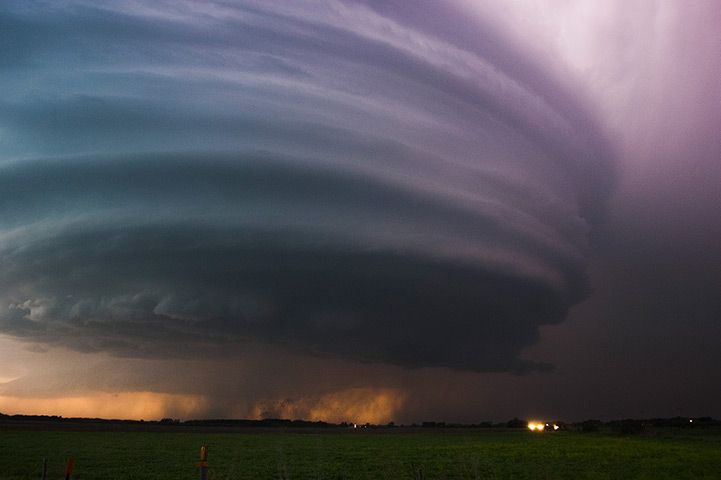 A supercell just north of Grand Island, Nebraska, US. Supercell thunderstorms rotate with immense energy, causing a strong updraft and severe weather, including tornadoes, hail, heavy rain, lightning and heavy winds