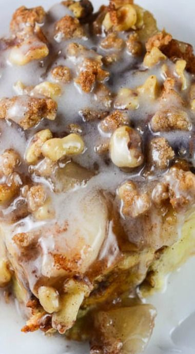Cinnamon Apple Pie Bread Pudding Recipe ~. A delicious, sweet bread pudding with apples, cinnamon, walnuts, and sugar drizzled with a sweet vanilla glaze that is super easy to make.