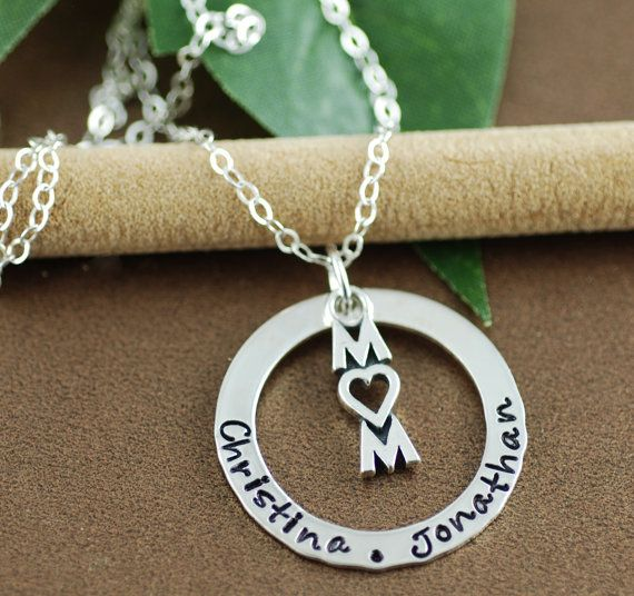 Check out this item in my Etsy shop https://www.etsy.com/listing/272357638/hand-stamped-mommy-necklace-personalized