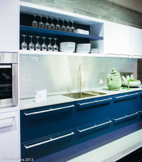 12 Kitchens with Color: In this photo snapped by kitchen designer Susan Serra at  IMM Cologne Living-Kitchen fair in Germany, dark blue and white mingle nicely, with a crisp and clean, but dramatic effect. Not sure the knitted teapot will be much use, though.