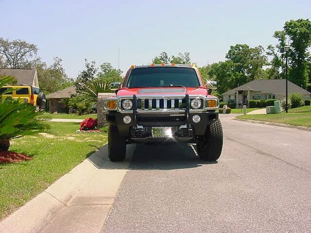 Picture #5-Note that Bonnie still has the same yellow Hummer (in driveway) she got at the end of 2005. April of 2010.