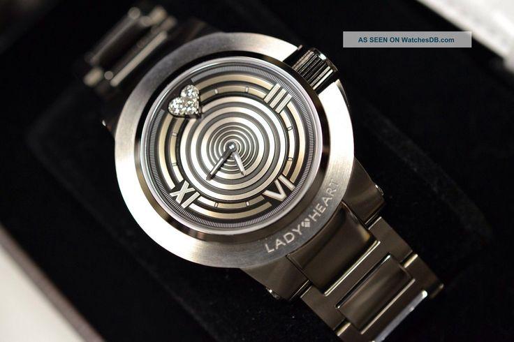 תמונה מאת http://timerecs.com/imgs/a/d/f/h/h/lady_heart_collection_diamond_watch___2_bands_nib_6_lgw.jpg.
