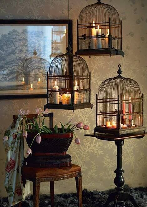 <<◇>>    Birdcages with candles are THE ABSOLUTE & MOST PERFECT      . . M U S T  H A V E . .               for us in the bedroom! maybe use chunky chain. or to easily light candles & daily dust; use bulky textured rope thru 2× pulley system in two corners of the room. to add drama tether end to a bird like my E.A.Poe crow. add a bright led precision light of some kind hidden beneath the cage for cozy night time reading. (quick tip: stain must match the headboard.)